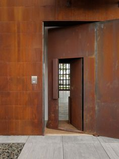 Seattle-based Olson Kundig Architects has designed the live-work home of a photographer and his family in the Spanish coastal town of Sitges. In Studio Sitges, Tom Kundig pursues his macho signature; large scale, raw concrete and rusty Corten steel. Pivot Doors, Sitges, Steel Doors, Entrance Doors, Entrance Ideas, Minimalist Living, Door Design, Windows And Doors, Interior Architecture