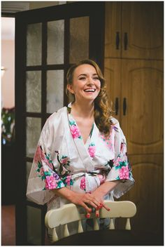 Portrait of a bride in a floral robe on her wedding morning