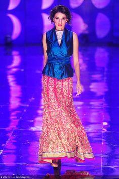 Alecia Raut walks the ramp to showcase a creation by designer Jyotsna Tiwari on Day 2 of the India Bridal Fashion Week (IBFW) 2013 at The Grand, Vasant Kunj in New Delhi