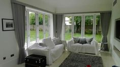 curtains for bi-fold doors Curtains: Consider heading styles with tight efficient stacking as large windows mean large stacks