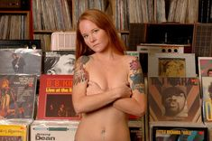 """Vinyl Virgins Welcome"" -- have naked girl peeling through stacks... covered up by record bins"