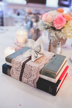 Stack books at each guest's place setting and make it fun with books that match each girl's personality or interests! | Smart Ideas for a Book Themed Bridal Shower | Rachel McCauley Photography | @myweddingfavors