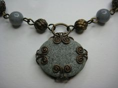 Necklace with a stone from our river Driva and Vintaj brass