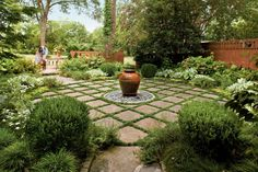 Side Terrace - The South's Best Gardens - Southernliving. An ornate urn fountain serves as this garden's focus while pavers bordered by dwarf mondo grass lend a riveting pattern to the space. See more Inspiring Landscape Design Boxwood Garden, Garden Trees, Sky Garden, Garden Fun, Shade Garden, Dwarf Mondo Grass, Organic Container Gardening, Lakeside Garden, Cottage Garden Design