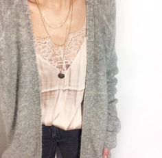 I love this look, a cozy sweater with feminine lace camisole underneath.