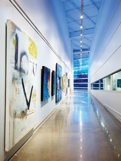 At A Boathouse by Rand Elliott, Sports and Arts Go Hand in Hand | Polished concrete flooring flows throughout, including the gallery. #design #interiordesignmagazine #projects #education #art #installation