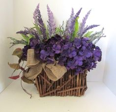 Gorgeous violet centerpiece arrangement by carolaflowerdesign, $60.00