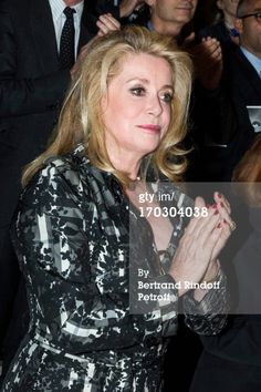 Actress Catherine Deneuve applauds as she attends a tribute to late fashion designer Yves Saint Laurent at Opera Bastille on June 10, 2013 in Paris, France. (Photo by Bertrand Rindoff Petroff/Getty Images)