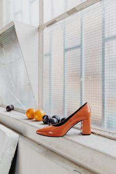 Block heel, patent vegan leather high heels. In statement tangerine colour.