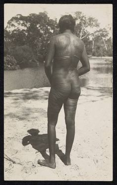 Australian aboriginal initiation and mourning rites of passage aboriginal man standing by a creek or river with his back to the camera displaying tribal m4hsunfo