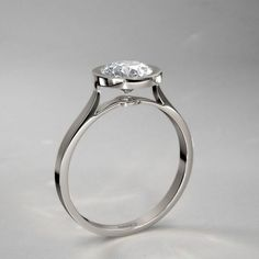 Exceptional Bezel Set Round Diamond Engagement Ring in 14k White Gold