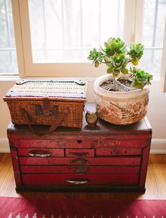 """Sneak Peek: Nicole Sutton of Workhorse. """"I like the character of this red tool box, especially """"Donald's"""" yellow signature. Sure its dented and bruised but I like that Donald and maybe others before him got some good use out of it. Plus it's fantastic for storage and it makes the perfect stand for a planter I brought home from a trip I took to Baja."""" #sneakpeek"""