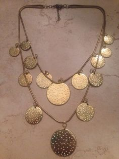 A personal favorite from my Etsy shop https://www.etsy.com/listing/244954487/vintage-gold-necklace-dangle-disc