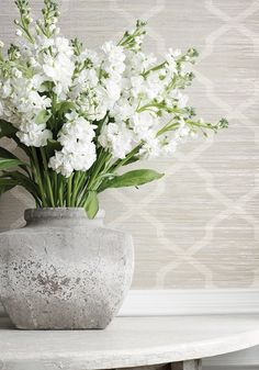 Carolyn Trellis Wallpaper A smart wide width horizontal paperweave with a trellis design printed in cream and pale aqua on a beige ground, and interspersed with metallic champagne foil strands. The design has been printed with a subtle weathered effect for added texture and interest.