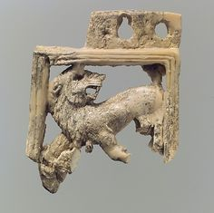 Openwork Ivory Plaque with a Lion. Neo-Assyrian ca. 9th–8th C. BCE  Mesopotamia…
