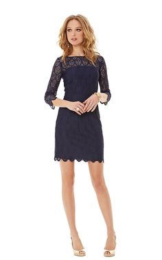 An essential piece for a cool fall evening  This fitted sheath dress has 34 length sleeves and a scallop hem.