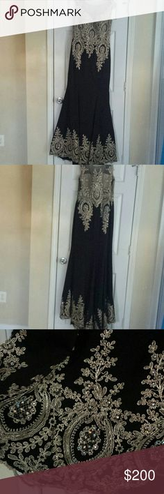 Beautiful black formal gown with gold detail Beautiful size large formal gown. It's black with gorgeous gold detail. The top is covered in sheer material and a nude material underneath. It's simply stunning. It was only worn once. star box Dresses
