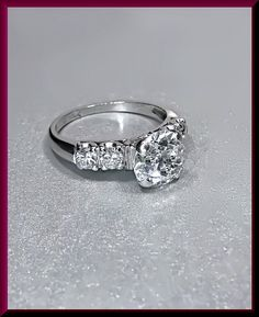 Set in 14k white gold, this 1940's engagement ring is classic luxury. The 1.50 ct center Old European cut diamond is K in color and VS2 in