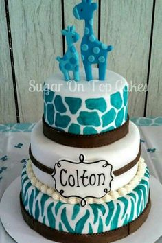 Brown and turquoise Giraffe baby shower cake with zebra print and giraffe print. Facebook.com/SugarOnTopCakes