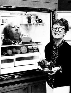 Photo of Alfred Hitchcock head prop in the fridge with his wife. Photo by Philippe Halsman. °