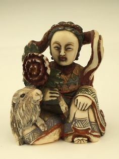 Antique carved Netsuke figure of a lady sitting next to a ram.