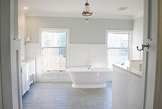 Not in love with the floors but love the white and wall color... Would be so great with pops of peacock blues and purples, maybe even yellow? Sherwin Williams sea salt paint.