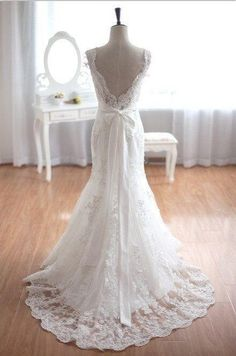 Backless lace dress with mermaid style and flare bottom. So pretty