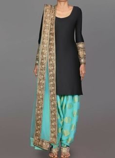 Black and Mint Brocade Punjabi Suit features a taffeta silk kameez alongside a brocade bottom with santoon inner and net dupatta. Embroidery is completed with zari, lace and stone embellishments. Indian Suits Punjabi, Punjabi Dress, Indian Attire, Pakistani Dresses, Indian Dresses, Indian Wear, Indian Outfits, Black Punjabi Suit, Punjabi Wedding Suit