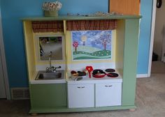 Repurposed Play Kitchen from an Entertainment Center.  Beautiful!