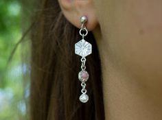 Asymmetric poppy crown stud earrings with pink opal