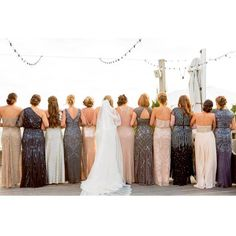 We spy lots of pretty #adriannapapell dresses in this shot!