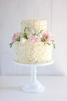 From Cake Ink. Coconut cake top tier and white chocolate mud cake bottom tier. Shaved coconut applied to white chocolate ganache finish.