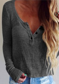 Front view of woman in dark grey long sleeve knit tee