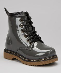 Styled after a cool combat silhouette, these polished boots will have little ones striding with attitude. Laces up the front, side zipper closures and pull tabs in back make them a cinch to pop on.