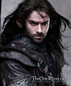 Kili - twin brother to Fili, they are nephews of Thorin.  Not so much bearded as scruffy-chinned, he's and his bother are very handsome Dwarves, as Dwarves go.