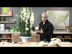 J shares the secret for using LESS Flowers and Creating a HUGE Arrangement in a Wreath RING... sharing this special trick... you can make large arrangements of flowers using much less flowers!