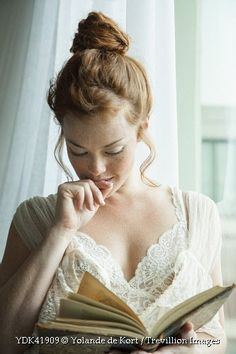 Trevillion Images - woman-reading-book