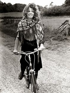"""Julie Christie Bikes on the Set (1970)  While filming The Go-Between, an out-of-costume Julie Christie rides a small-wheel BSA """"Twenty"""" folding bike between scenes in Norfolk, Va. Not only biking, but  wearing a crochet granny shawl !"""
