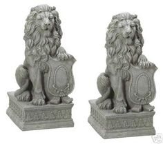 Two (2) crested shield lion garden statues, yard lions