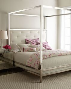 This Canopy Bed is definitely not your typical canopy.  The Bernhardt Canopy Bed features the best in modern design with a tufted head board and canopy post.  The chrome finish would bring a pop of glam to any room.  This bed is Gorge!!! Love love love....