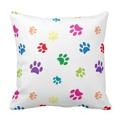 Rainbow Painted Paw Prints Pillows by Purple Cat Arts. Show your love for…