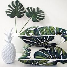 For Ryan and Layla's room --- maybe mid century furniture, bold palm curtains and crib skirt, and bold Kelly green/white bedding and accents.