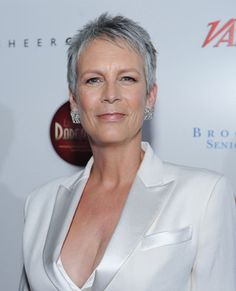 Jamie Lee Curtis has embraced her grey, which looks great on her oval face. Her naturally coarse hair is thick and unruly, but her cut tames it. This style does require confidence, however, and a touch more make-up.