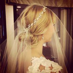 Bride wearing a Maria Elena Headpiece Swarovski Crystal and Mother of pearl Headband