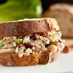 Sonoma Chicken Salad Sandwich    3½ cups cooked, shredded chicken   1 cup diced celery (about 3 stalks)  ⅔ cup chopped pecans  ½ cup dried cranberries, chopped  2 T finely grated Parmesan   ⅔ cup mayo  ¼ cup apple juice  3 T honey  2 tsp apple cider vinegar  1tsp prepared yellow mustard (optional)  1 T poppy seeds  ½ tsp onion powder  Salt and freshly ground black pepper to taste