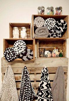 Vintage wine box shelves in bathroom + pallet to hang towels + fun graphic towels