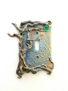 Single Switchplate. One Tree switch plate in brown and blue