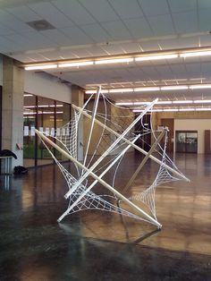 Large scale 6 strut tensegrity sculpture, with tensile membranes.