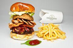 Kickass Burger with salmon, chicken, bacon, onion rings...  www.202hamburger.com www.212hamburger.com