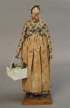 Figura di carta di una cameriera Germania, circa 1800. --- Wooden Doll dressed as a servant, circa 1800.